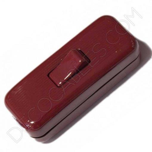 Interruptor de paso en color granate