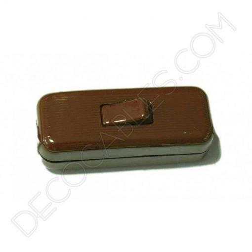 Interruptor de paso en color marrón